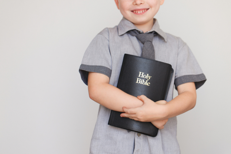 Kid holding Bible