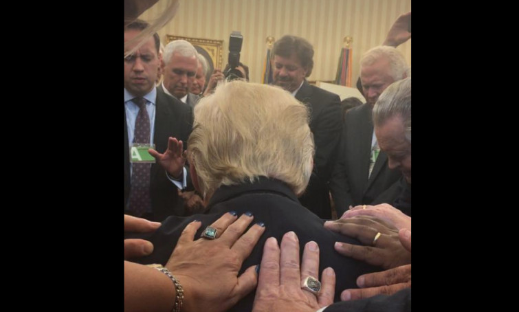 laying hands president trump