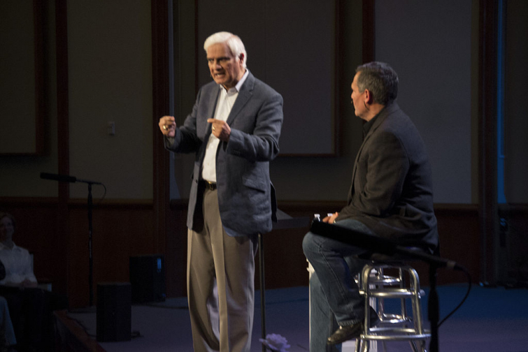 Ravi Zacharias talks to pastor Joe Coffey at Christ Community Chapel about answering objections to Christianity. (Photo by TMDrew)
