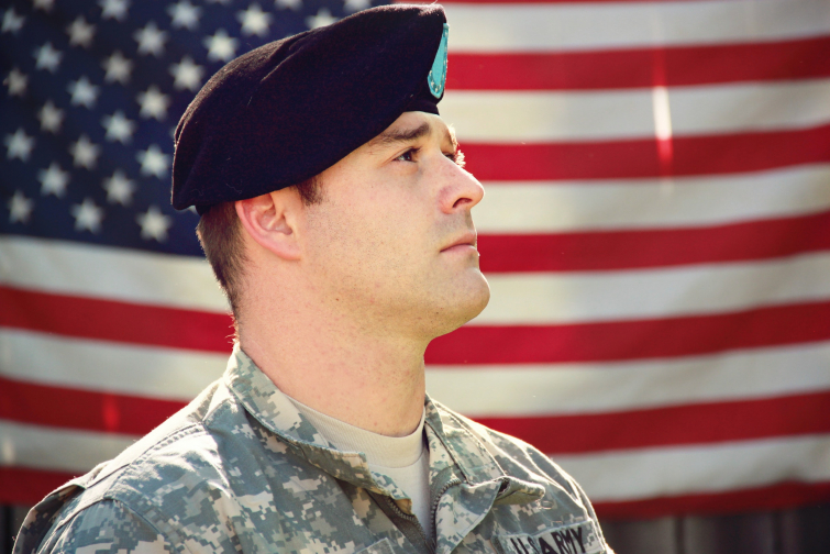 United States Army Combat Veteran with American Flag (Photo: Pexels)