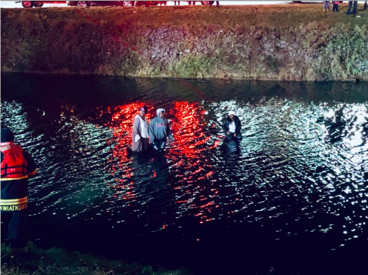 Rescue After Cars Slid On Black Ice Into Pond (Photo: Twitter)