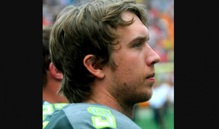 Nick Foles, quarterback for the Philadelphia Eagles, stands with his hand over his heart during the national anthem before the 2014 Pro Bowl at Aloha Stadium Jan. 26. (Photo: Sgt. Kyle Richardson)